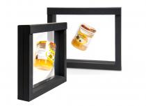 Schwebendes Honigglas im Rahmen
